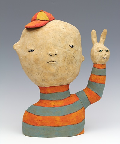 clay ceramic sculpture boy with rabbit hand peace by sara swink