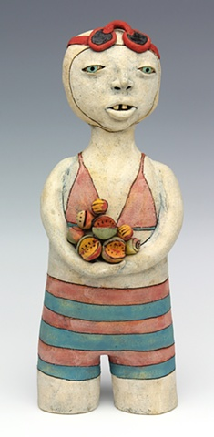 clay ceramic sculpture swimmer fruit by sara swink