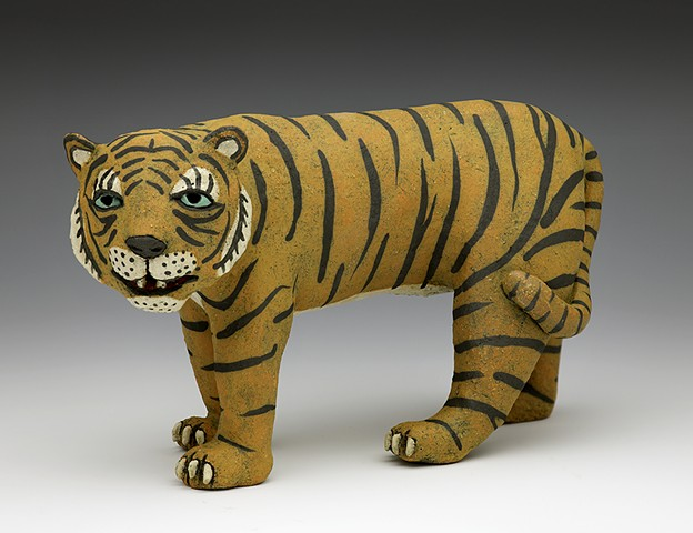 Ceramic tiger stripes teeth by Sara Swink