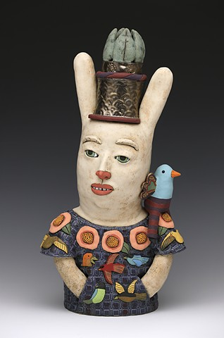 ceramic sculpture Sara Swink bird flowers crown leaves wings rabbit huipil