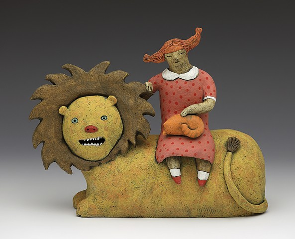 ceramic figure clay lion cat lap cat, girl polka dot dress pigtails teeth by Sara Swink