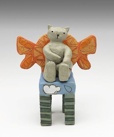 ceramic figure cat wings sun clouds rain chair by Sara Swink