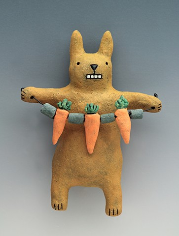 ceramic figure rabbit carrot bunny wall art pottery by Sara Swink