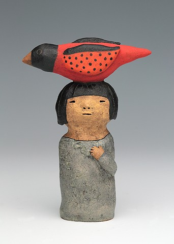ceramic figure with bird by Sara Swink