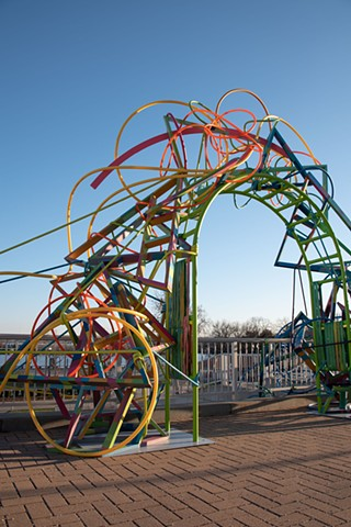 Heather Brammeier Easterseals Rainbow art installation our common threads plastic tubing garden hose reclaimed materials