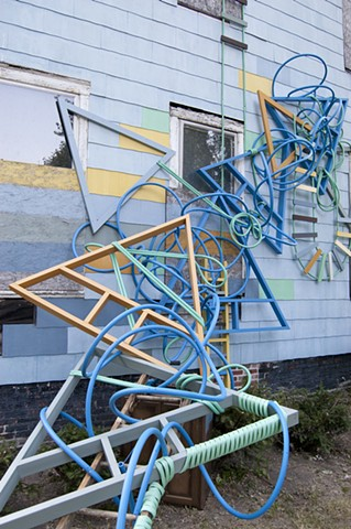 artwork installation sculpture colorful artwork progression PEX tubing reclaimed materials ladders