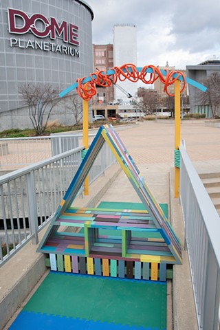 Heather Brammeier Easterseals Rainbow art installation our common threads triangle bench interactive