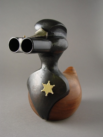 Sheriff Rubber Ducky made from 20 gauge double shotgun barrels.
