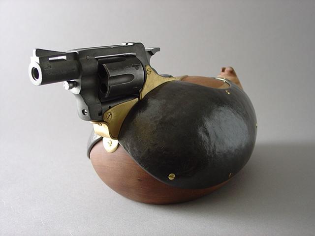 Duck decoy sculpture made from a revolver.