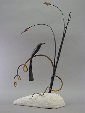 Redwing Blackbird perched on sea oats, forged steel and limestone.