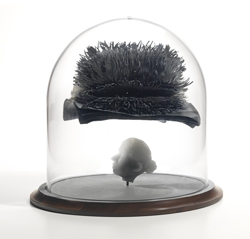 cast glass head with cut paper hand dyed and bound book with hands in bell jar by leigh craven