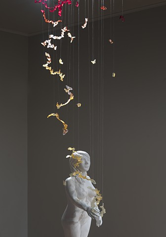 installation with ceramic and mixed media figure with resin butterflies by leigh craven