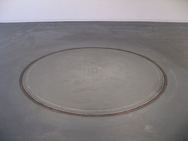 burn out: state dependent memory,  cleaned gallery floor.  240 cm dia.