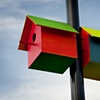 birdhouses auto lacquer on wood, cable ties on light pole Perth Cultural Centre each house 34 x 39 x 41 cm