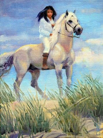 Girl on a white horse on top of sand dune.