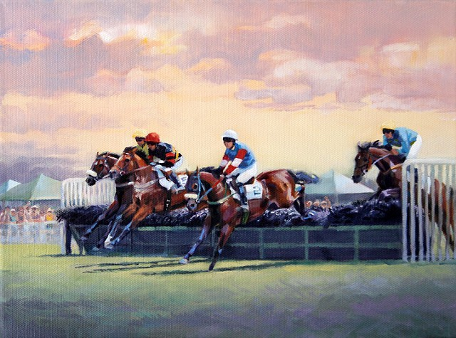 Steeplechase Racers going over a hurdle at the races.