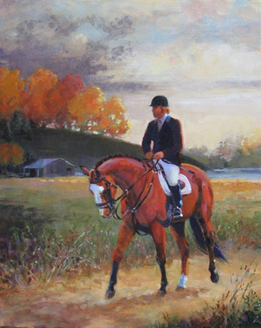 A horseback rider is out in the countryside in early morning.