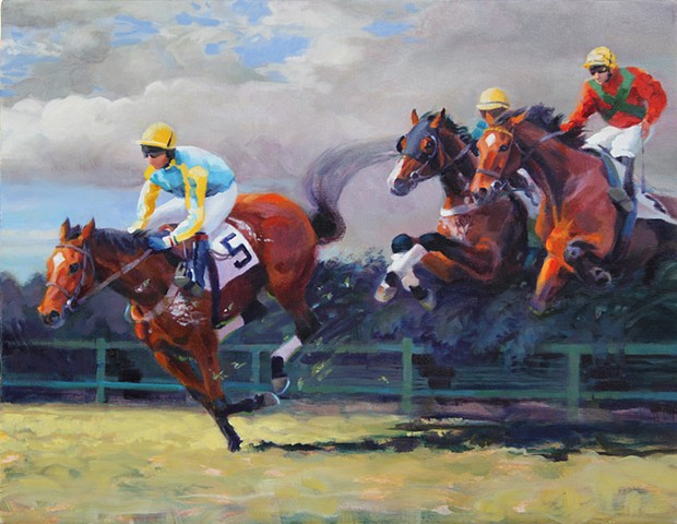 Steeplechase riders on horseback going over a fence