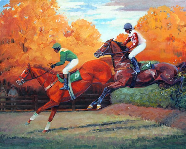 Two horses jumping over a fence in a steeplechase race with fall foliage.