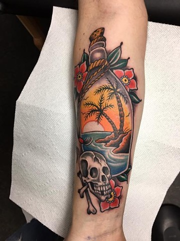 Paradise Tattoo skull bottle palm trees colour traditional flash design custom janman winnipeg first string flowers arm