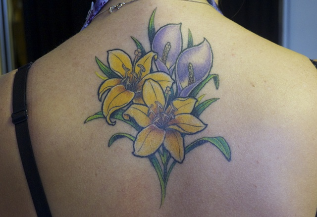 Lily flower tattoo by J. Majury