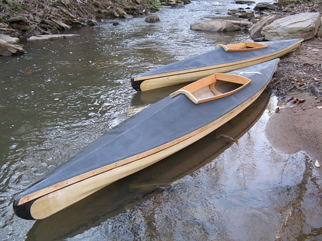 Hand built English Kayaks used for Waters of Oblivion film and installation Boat Builder: Oliver Sudden