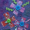 "42   Purple Triplet Candy Wrapper  Flower Fiber: Framed Contemporary Art Quilt 9""x11""  Hand-dyed and commercial fabrics. Candy wrappers, buttons, found objects. Tulle, vegetable bags, netting.  Hand-dyeing, heat bonded collage, Sheer overlays ,Machine sti"