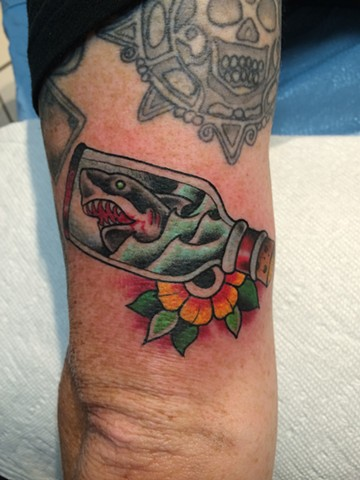 tiny shark in bottle tattoo