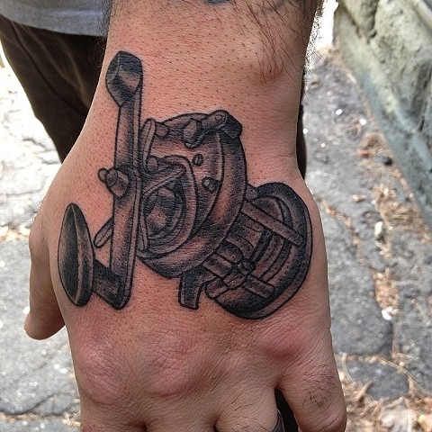 fishing reel tattoo