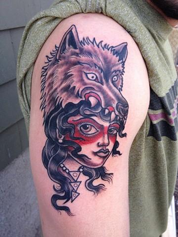 wolf head woman tattoo