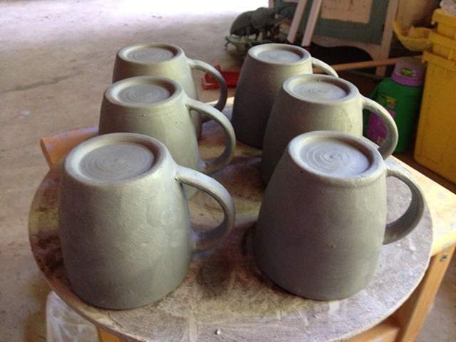Attaching handles to mugs