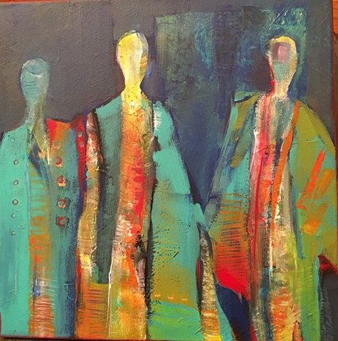 Three cloaked figures