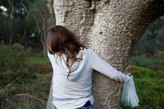 Alex hugging a live oak tree while mushroom foraging, Los Osos