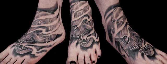 large cat skull black and grey foot tattoo