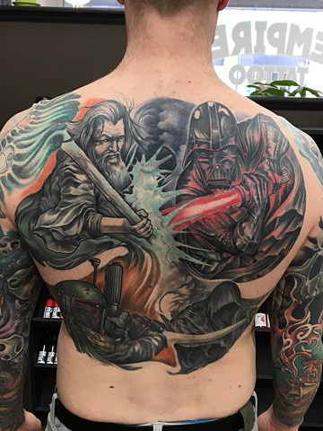 full color back piece tattoo illustrative semi realistic darth vader bobafet and wizards