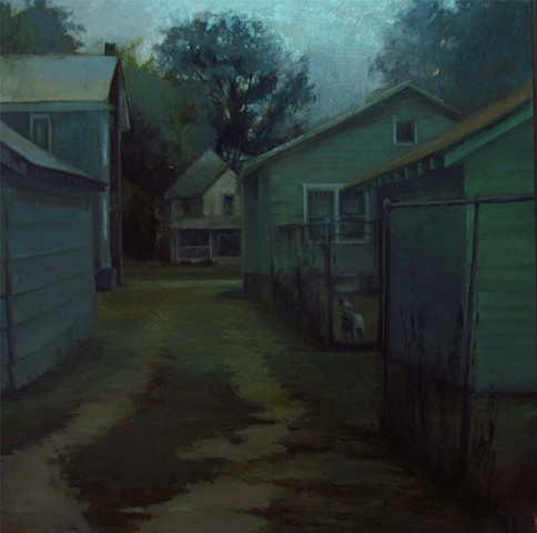 Alley in Newton Kansas with dog behind fence watching over the place Bethel College Exhibit