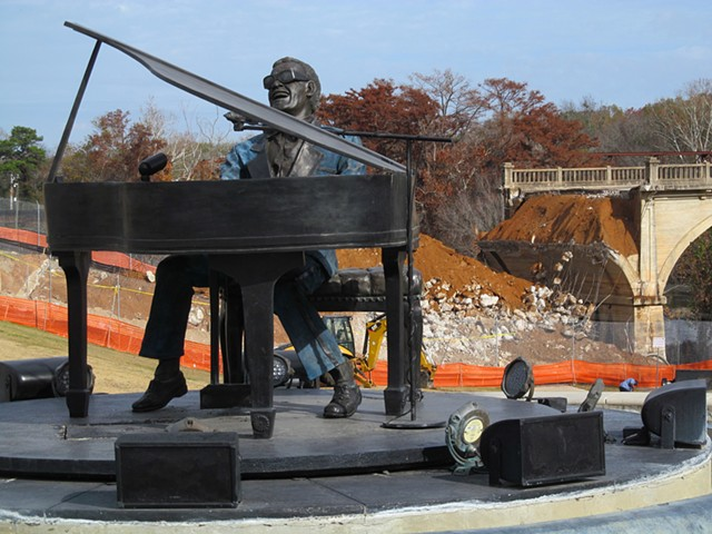 "America the Beautiful.  This statue of Ray Charles (designed by sculptor Andy Davis) is frequently photographed.  Piped in music plays Charles' music in the park.  As I walked past, his version of ""America the Beautiful"" was playing, and I couldn't resist"