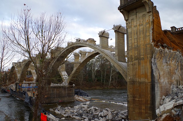 All arches exposed and ends coming down.  Upstream west bank.