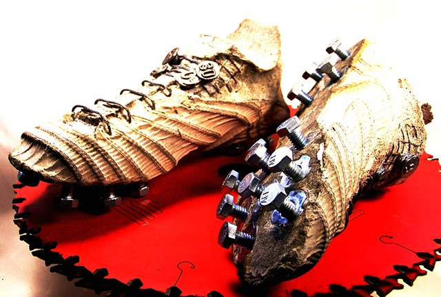 Abby's cleats metal spikes.  Home com. Lisa Sweeney mom