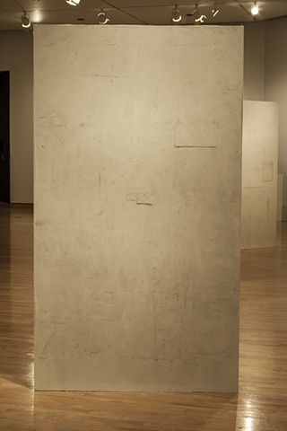 Studio Walls represented on panels wrapped with paper.