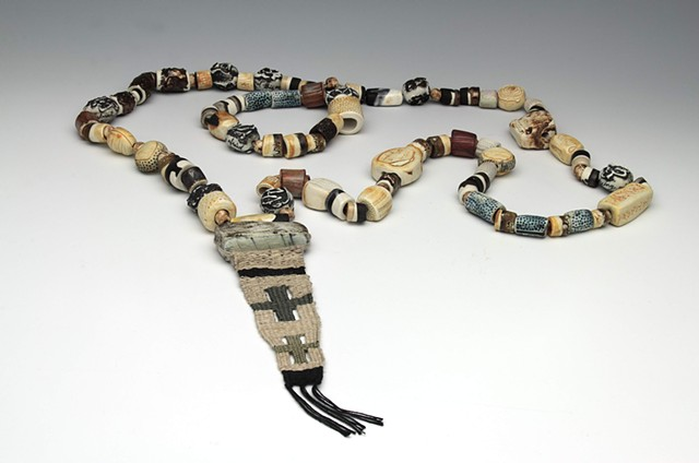 hand-built porcelain rosary finished with underglazes, oxides, and glazes