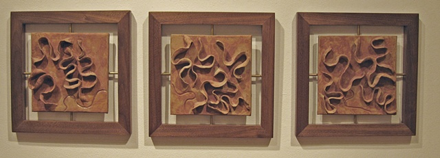 wood and clay wall pieces