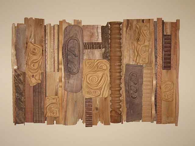 wood and clay wall piece