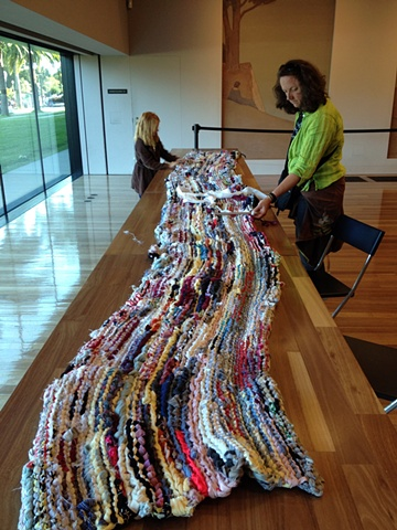 """Visitors participating in """"Weaving the Past into the Tapestries of Today: African American Folk-Art Traditions and Contemporary Textiles"""" at the de Young Museum"""