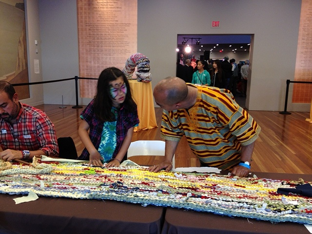 "Visitors participating in ""Weaving the Past into the Tapestries of Today: African American Folk-Art Traditions and Contemporary Textiles"" at the de Young Museum"