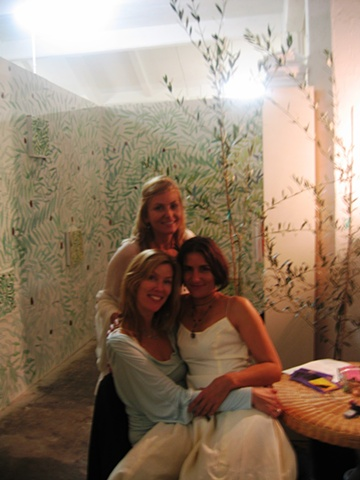 "Goddesses and guests relaxing in the theatrical installation environment ""Olive Grove Project"" by Eugenia Mitsanas for Workspace Ltd. Gala Opening"
