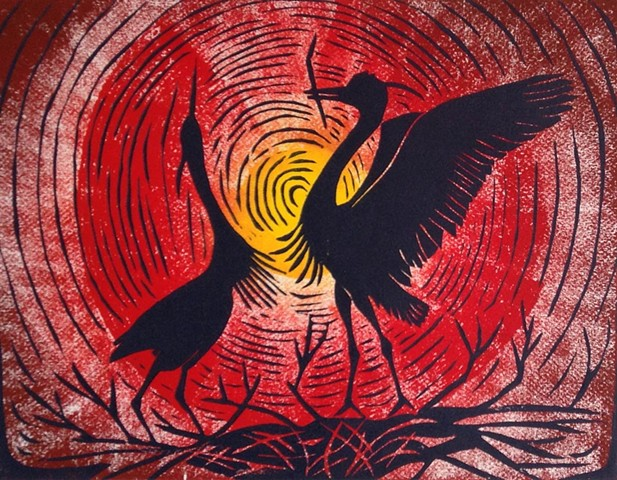 a woodcut of two great blue herons dancing on their nest with a rainbow background by Leslie Moore of PenPets
