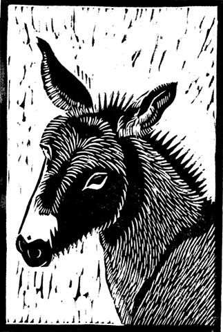 a black linocut of a burro by Leslie Moore of PenPets