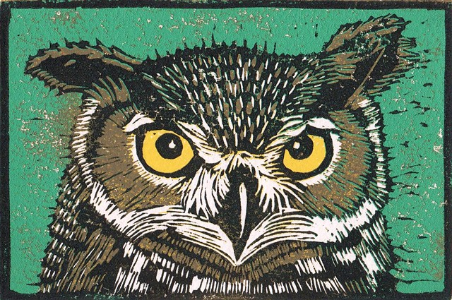 a reduction linocut of an owl by Leslie Moore of PenPets