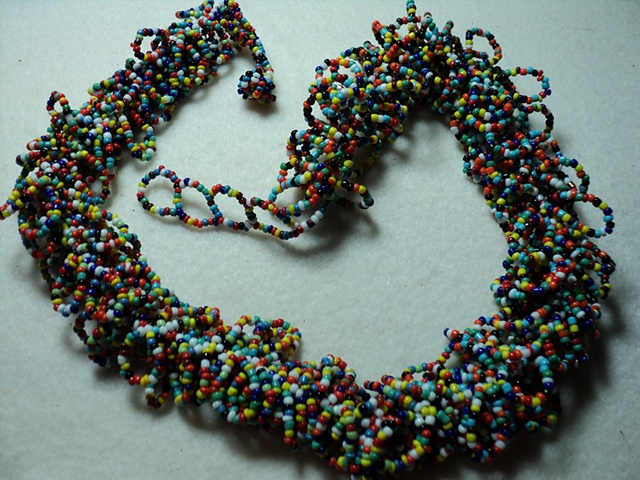 multi-colored, looped strand, glass seed bead necklace